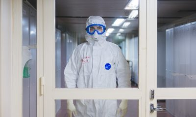 person in white jacket wearing blue goggles